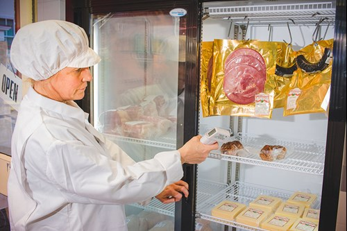 A Mid Devon District Council Food Safety Inspector checks the temperature of refrigerated meat