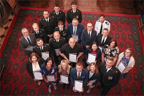 Image of the 22 recipients with their comendations at the Exceptional Contribution to Policing in Devon Awards