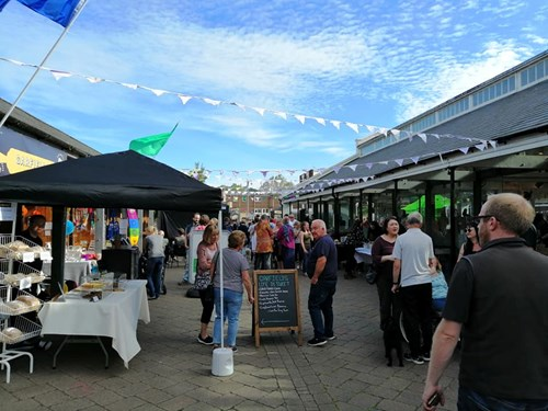 Image of punters at Electric Nights street food event at Tiverton Pannier Market
