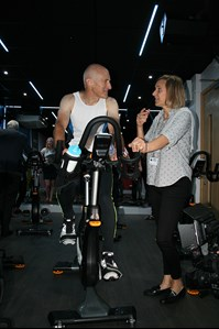 Councillor Moore trying out one of the new CXP Target Training Cycles whilst receiving instruction from Leisure Manager, Corinne Parnall