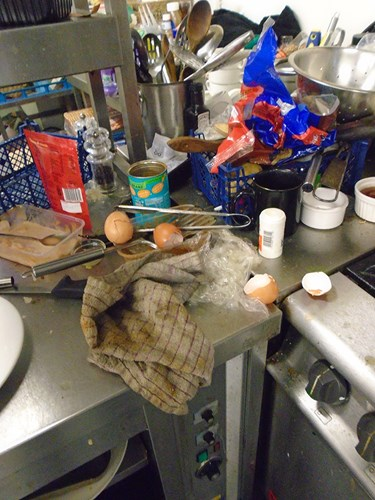 Image of food waste and clutter in the kitchen of The White Hart