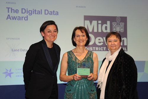 Mid Devon District Council's Pauline Davey (centre) collects the award from Land Data's Jan Boothroyd (Right) and comedian Zoe Lyons (right)