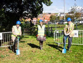 Cllr Bob Deed cuts the turf at Crediton's new health hub